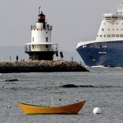 Gabe Souza/Portland Press Herald The Nova Star ferry travels past fishermen and tourists near the Spring Point Ledge Light on its way to the Ocean Gateway terminal in Portland. With the decline of groundfishing and freight shipping, Portland increasingly relies on tourists passing through its port.