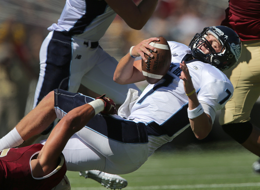 Maine quarterback Dan Collins was sacked five times Saturday in the 24-3 loss at Boston College but seemed to have a better handle on the offense. The Black Bears were hurt by the suspension of running back Nigel Bickford.