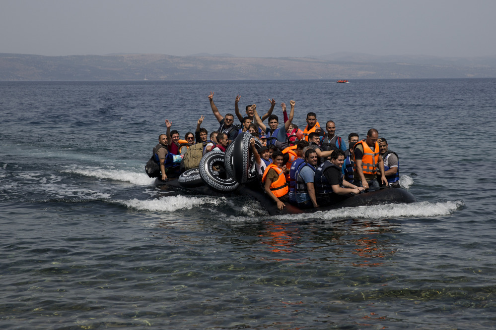 Syrian refugees arrive Monday on the island of Lesbos, Greece, after crossing from Turkey. The Obama administration faces increasing pressure as thousands of refugees from war-torn countries make desperate attempts to reach Europe.