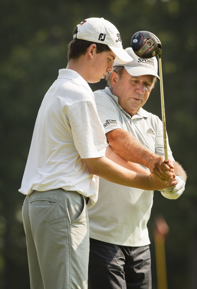 Jack Kelley of Cape Elizabeth receives instruction from Peter Kostis, a Sanford native who owns a home at the Falmouth Country Club and frequently works with the top golf professionals in the world.