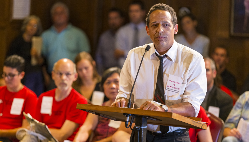 Michael Araujo, an organizer for Restaurant Opportunities Center United, makes his case Wednesday night for the Portland City Council to approve an increase in the city's minimum wage for workers who earn tips. Ben McCanna/Staff Photographer