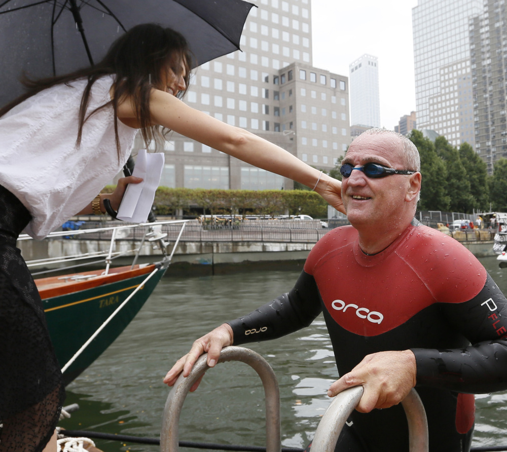 Martin Strel is greeted by his daughter Nina after completing his swim from the Statue of Liberty to Manhattan's North Cove Marina on Thursday in New York.