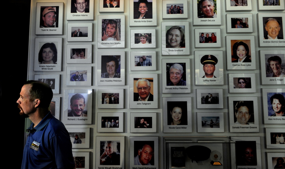 Gordon Felt, president of Families of Flight 93, stands before a wall featuring photos of those killed on Flight 93. Felt's brother Edward was among the crash victims.