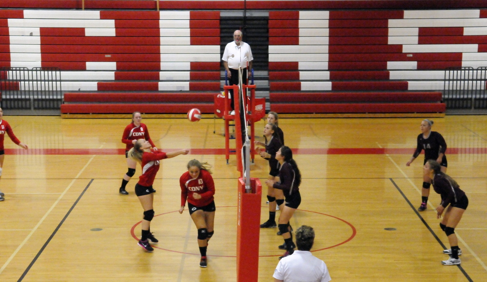 The Cony High volleyball team returns a shot Thursday night during a match against Gorham in Augusta. Gorham came away with a three-game victory, 25-13, 25-20 and 25-14.