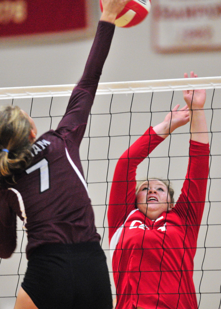 Diana Kolb of Gorham takes a shot at the net that Hannah Kibben of Cony attempts to block. Gorham improved its record to 2-1 with the victory and dropped Cony to 1-2.