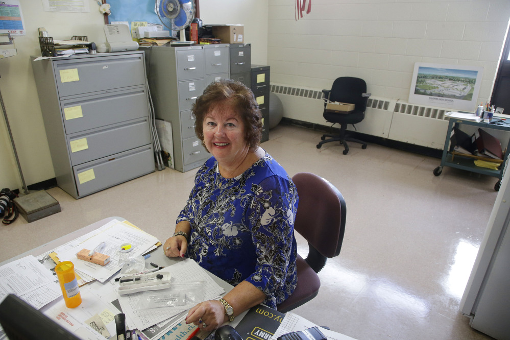 High school nurse Kathleen Gage, instrumental in working for the accepted use of Narcan in Rhode Island schools, sits at her desk at Pilgrim High School.