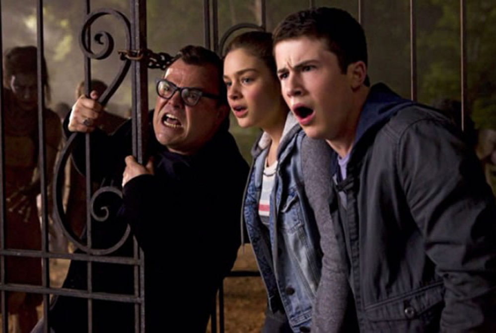 "Jack Black, Odeya Rush and Dylan Minnette in ""Goosebumps."""