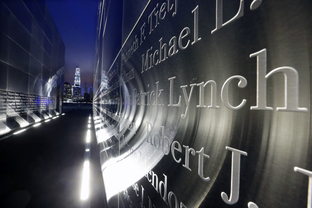 The names of New Jersey's victims of the Sept. 11, 2001, terrorist attacks are seen on a memorial in Jersey City on Friday – the 14th anniversary of 9/11 – as 1 World Trade Center stands at center left. Close to half of the first responders and volunteers who worked at the three attack sites have developed an illness.