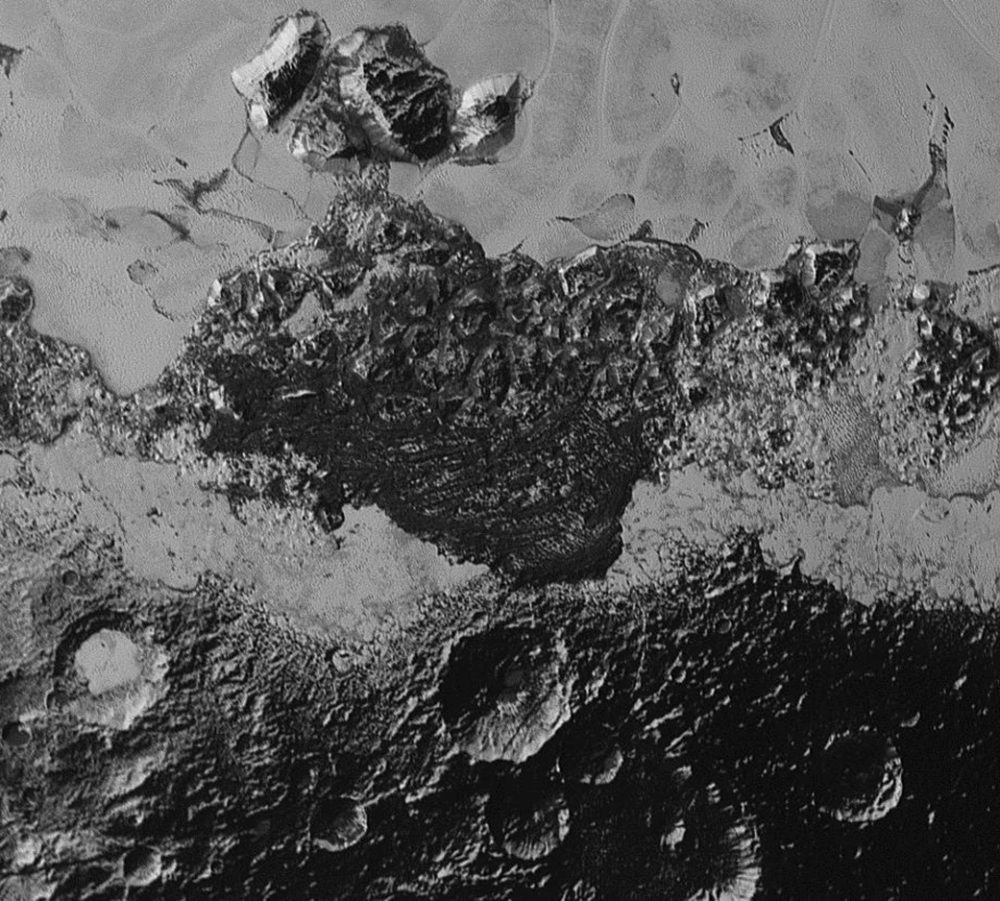 This July 14 photo provided by NASA shows a 220-mile-wide view of Pluto taken from the New Horizons spacecraft. The new close-up images of Pluto reveal an even more diverse landscape than scientists imagined before New Horizons swept past Pluto in July.