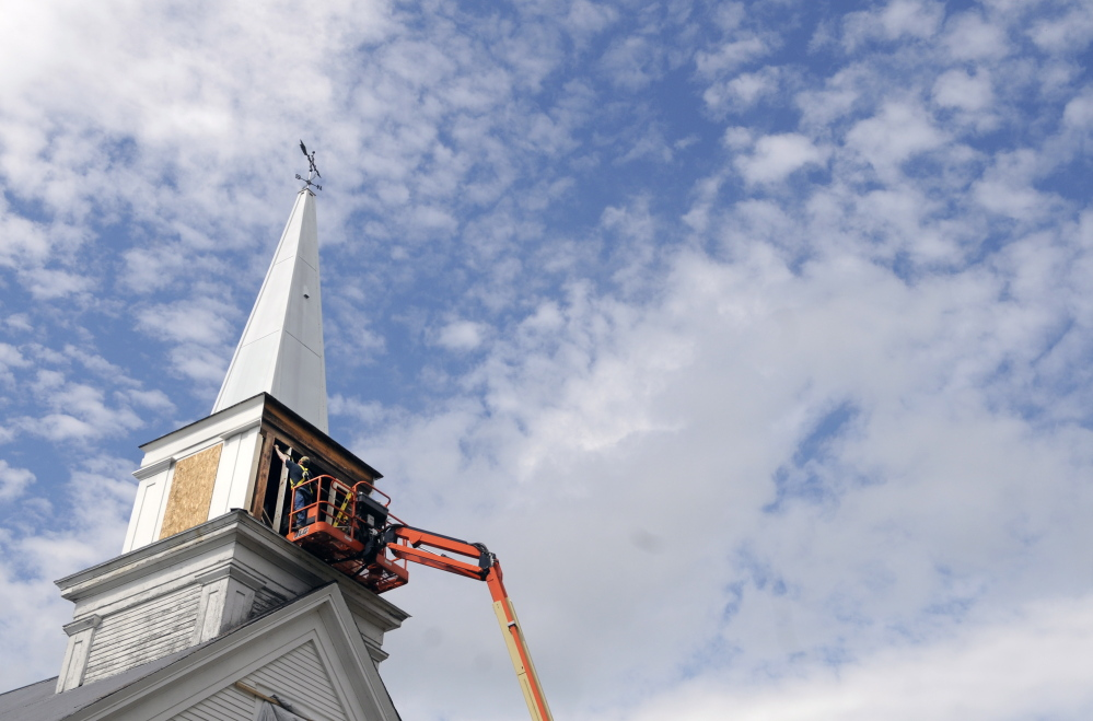 "Workers frame the steeple at the North Monmouth Community Church earlier this week. Pastor Edward Spencer and the Church Council decided to borrow $28,000 to do the work. ""The steeple was just so ugly compared to the rest of the church,"" Spencer said."