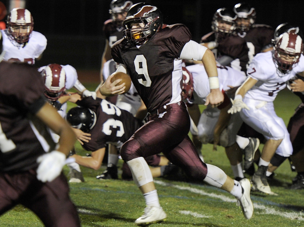 Kyle Houser of Windham finds lots of running room Friday during the Eagles' 42-0 win over Bangor. Houser rushed for 186 yards and two touchdowns.