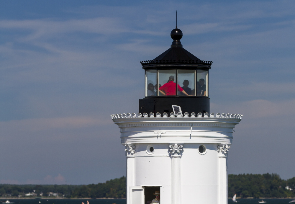 Visitors gather at the top of Bug Light in South Portland as it was opened to the public for free.