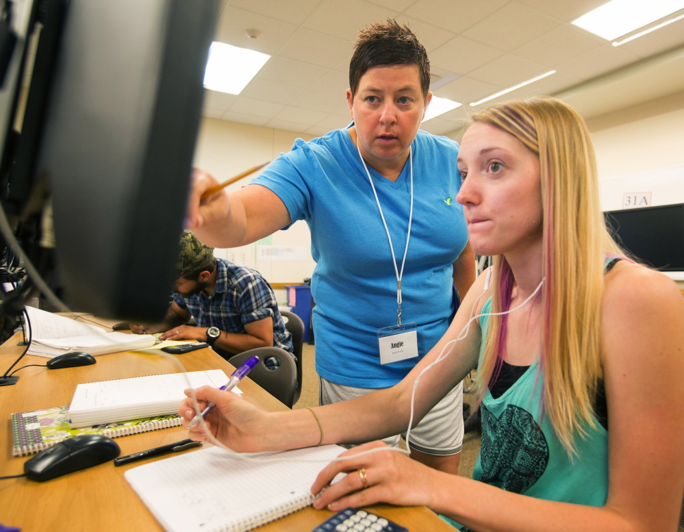 Tutor Angie Foster, center, helps student Krystal Huffman  at Big Bend Community College in Moses Lake, Wash., where learn-at-your-own-pace math classes are offered.