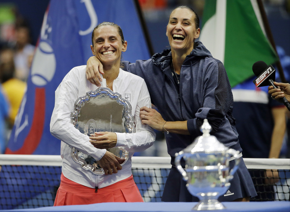 Roberta Vinci, left, and Flavia Pennetta both had plenty of reason to smile Saturday after the U.S. Open final. Vinci upset Serena Williams on Friday to reach the final, and Pennetta won the title, then announced her retirement.