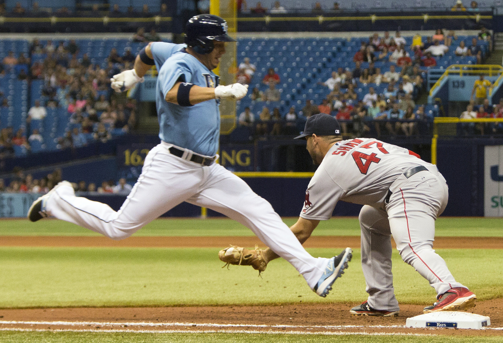 Red Sox first baseman Travis Shaw makes a force-out against Tampa Bay Rays shortstop Asdrubal Cabrera in the ninth inning Sunday in St. Petersburg, Fla. The Associated Press