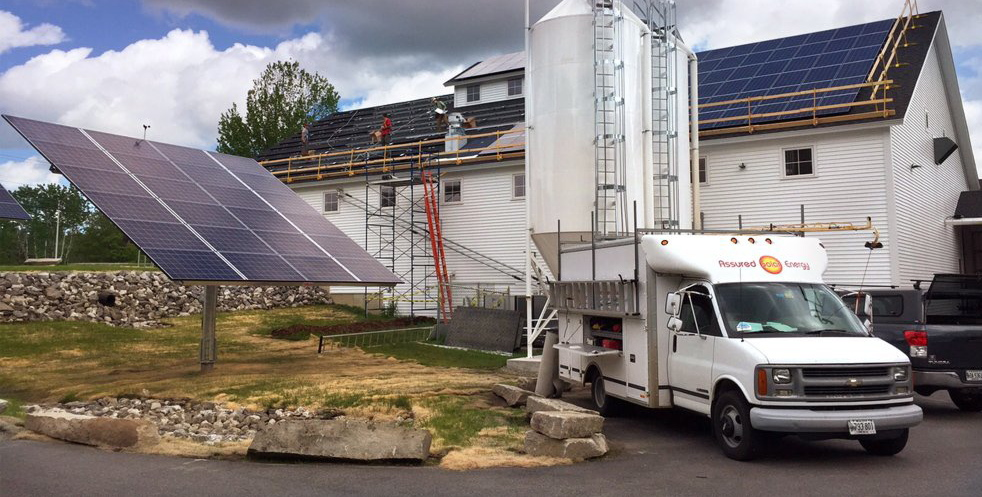 Assured Solar Energy installs a solar power array at the Maine Beer Co. in Freeport earlier this year.