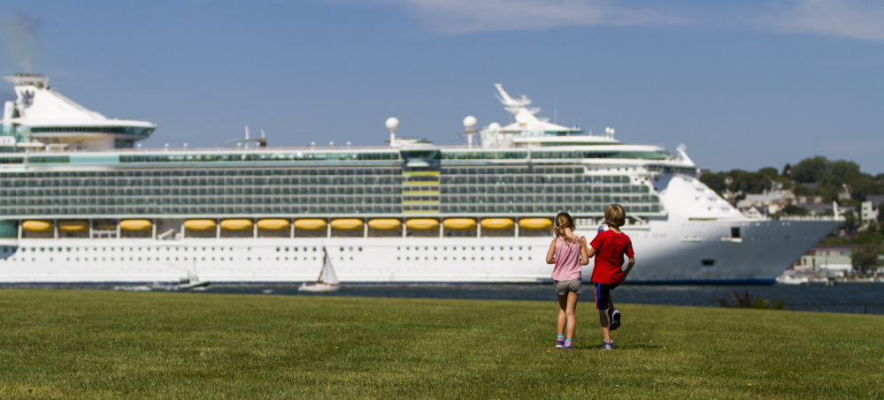 In this 2015 file photo, Audrey LeBleu of South Portland and Harry Converse of Cape Elizabeth take a look at the cruise ship Liberty of the Seas from Bug Light Park in South Portland.