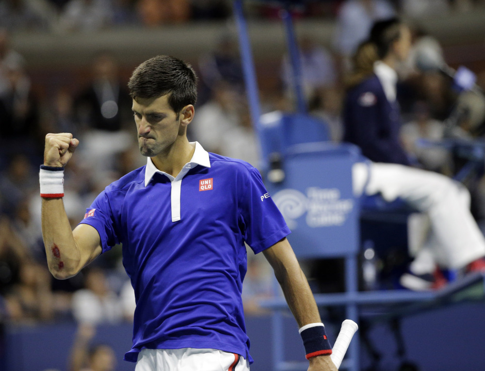 Novak Djokovic of Serbia clenches his fist while playing Roger Federer of Switzerland during the U.S. Open men's final Sunday in New York.