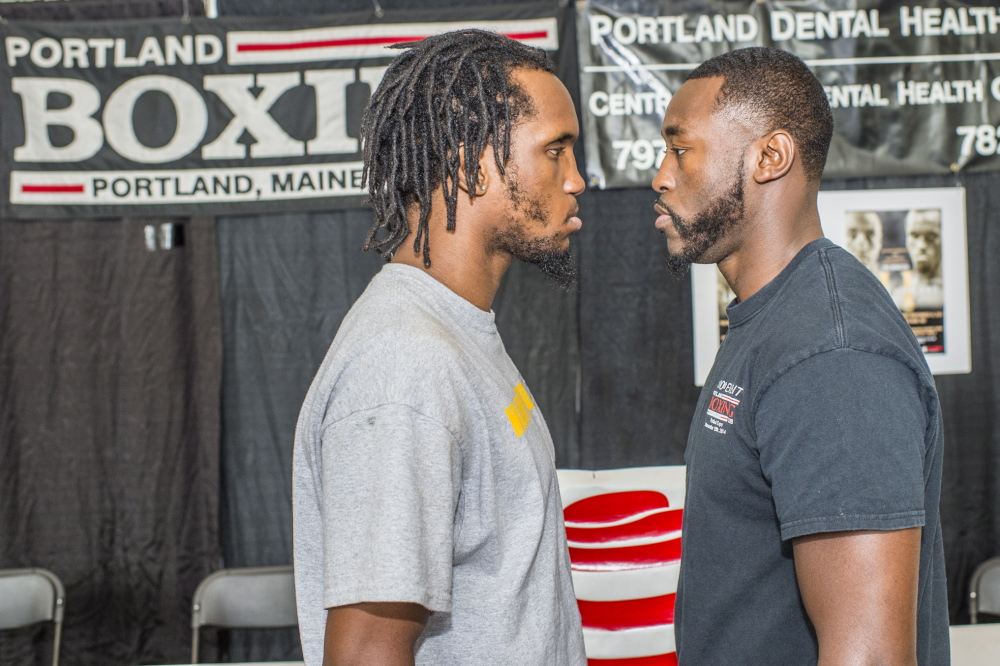Thomas Falowo of Pawtucket, R.I., left, and Russell Lamour Jr. of Portland appear at a news conference Monday to announce a rematch of their New England middleweight title fight, which will take place at the Portland Expo on Nov. 14. Patrick Scholz/Special to the Press Herald