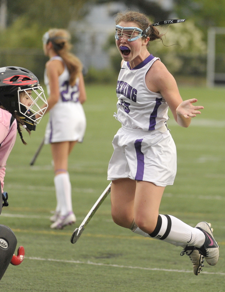 Kerry Wells of Deering celebrates after tying the game with 1:34 remaining Monday, but Portland came back to score the winning goal 11 seconds later.