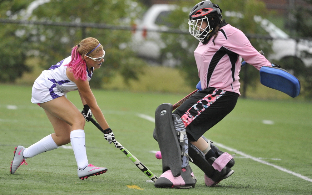 Gianna Gaudet, who played a splendid game in goal for Portland, blocks a scoring bid from Kaytlin DiBiase, who did score two goals for Deering.