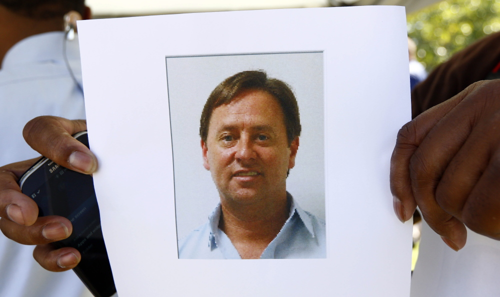 Shannon Lamb, displayed in a digital photograph released by the Mississippi Department of Public Safety investigators to members of the media and held by a reporter, killed himself after shooting Delta State University history professor Ethan Schmidt.