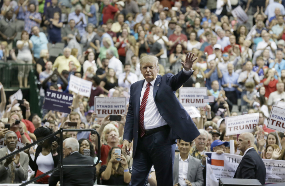 Republican presidential candidate Donald Trump waves to supporters after speaking at a campaign event in Dallas, Monday.