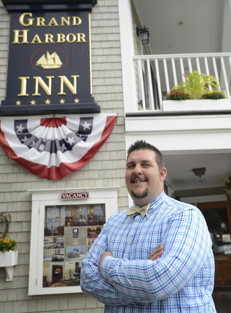 "Erick Anderson manages The Lord Camden Inn and Grand Harbor Inn in Camden. ""Every day is completely unlike the other,"" he said."