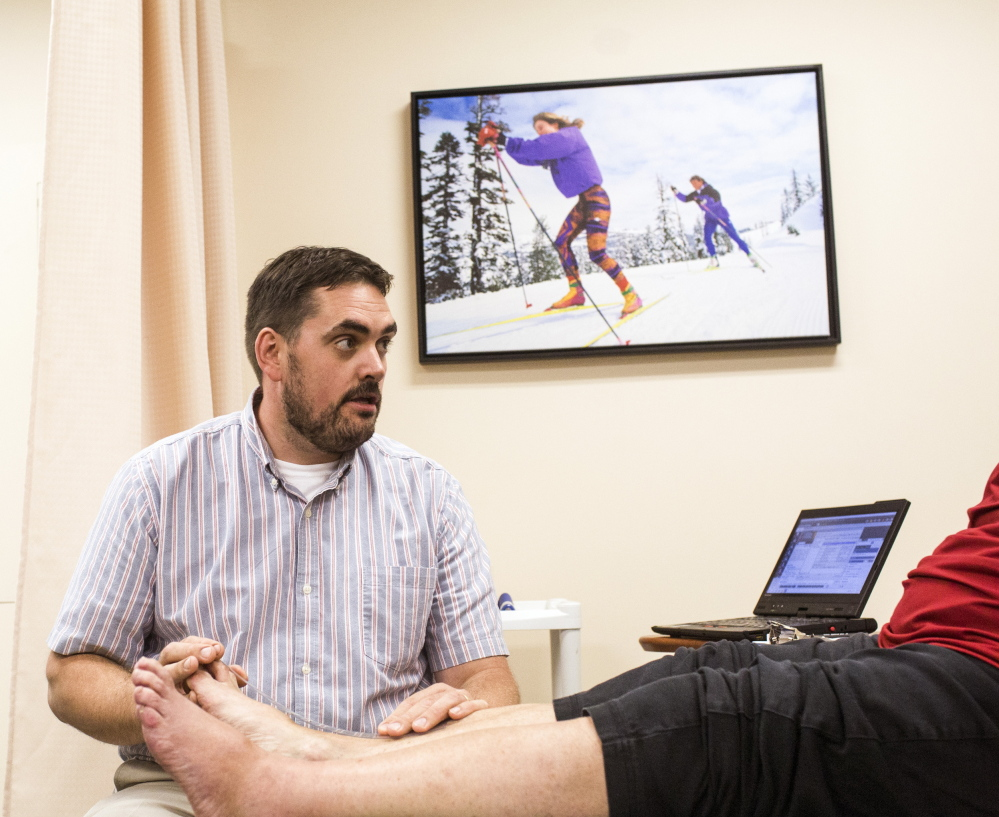 Physical Therapy Coordinator Todd Lamoreau works with a patient at InterMed in South Portland. Whitney Hayward/Staff Photographer