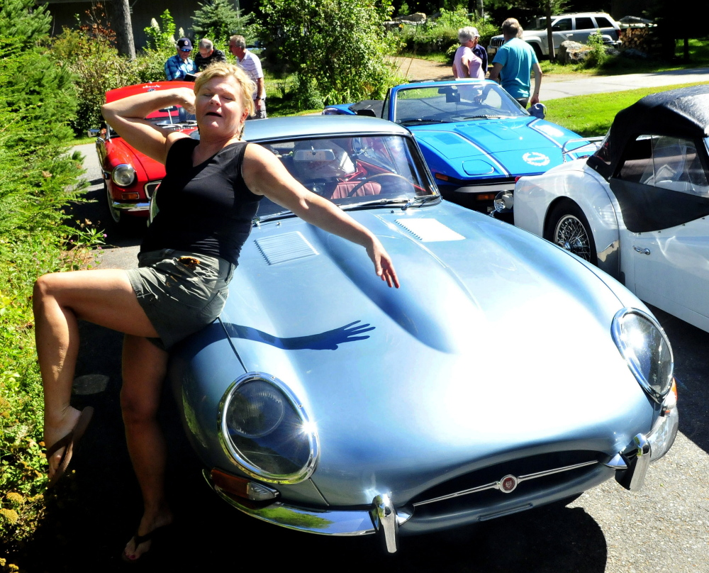 Nona Fuller of Nova Scotia poses with her 1966 Jaguar E-Series sports car Tuesday at a stop in North Belgrade. Fuller and others with the British Automobile Touring Association Nova Scotia, were driving their British cars from Nova Scotia to Vermont.