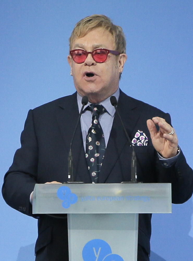 "Sir Elton John speaking  during the 12th  Annual Meeting entitled ""At Risk: How New Ukraine's Fate Affects Europe and the World"" organized by the Yalta European Strategy (YES) in partnership with the Victor Pinchuk Foundation at the Mystetsky Arsenal Art Center in Kiev, Ukraine, Saturday, Sept. 12, 2015. Sir Elton John delivered a keynote speech  about the role of business in promoting human rights.  More than 200 leaders from politics, business and society representing more than 20 countries will discuss major global challenges and their impact on Europe, Ukraine and the world. (AP Photo/Efrem Lukatsky)"