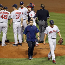 """Red Sox starter Joe Kelly walks off the field with """"shoulder tightness and fatigue"""" in the third inning of Tuesday night's game against the Baltimore Orioles. It was the first time in eight starts that he allowed more than two earned runs."""