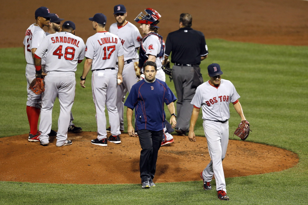 "Red Sox starter Joe Kelly walks off the field with ""shoulder tightness and fatigue"" in the third inning of Tuesday night's game against the Baltimore Orioles. It was the first time in eight starts that he allowed more than two earned runs."