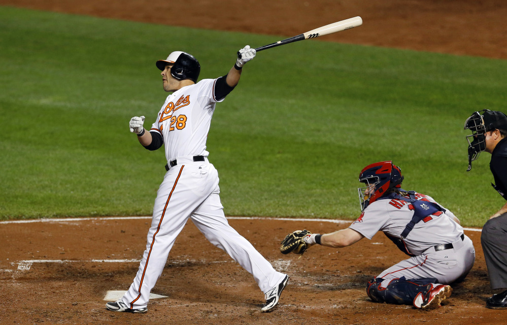The Orioles' Steve Pearce watches his two-run home run in the third inning. The game went 10 more innings before Baltimore won, 6-5.