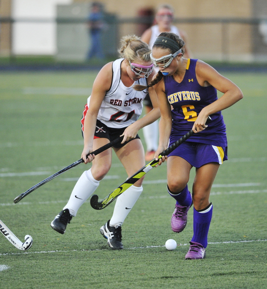 Scarborough's Ashley Levesque, left, and Cheverus' Sophia Pompeo, battle for control of the ball in Wednesday's field hockey game at Scarborough. The Stags held on for a 2-1 win.
