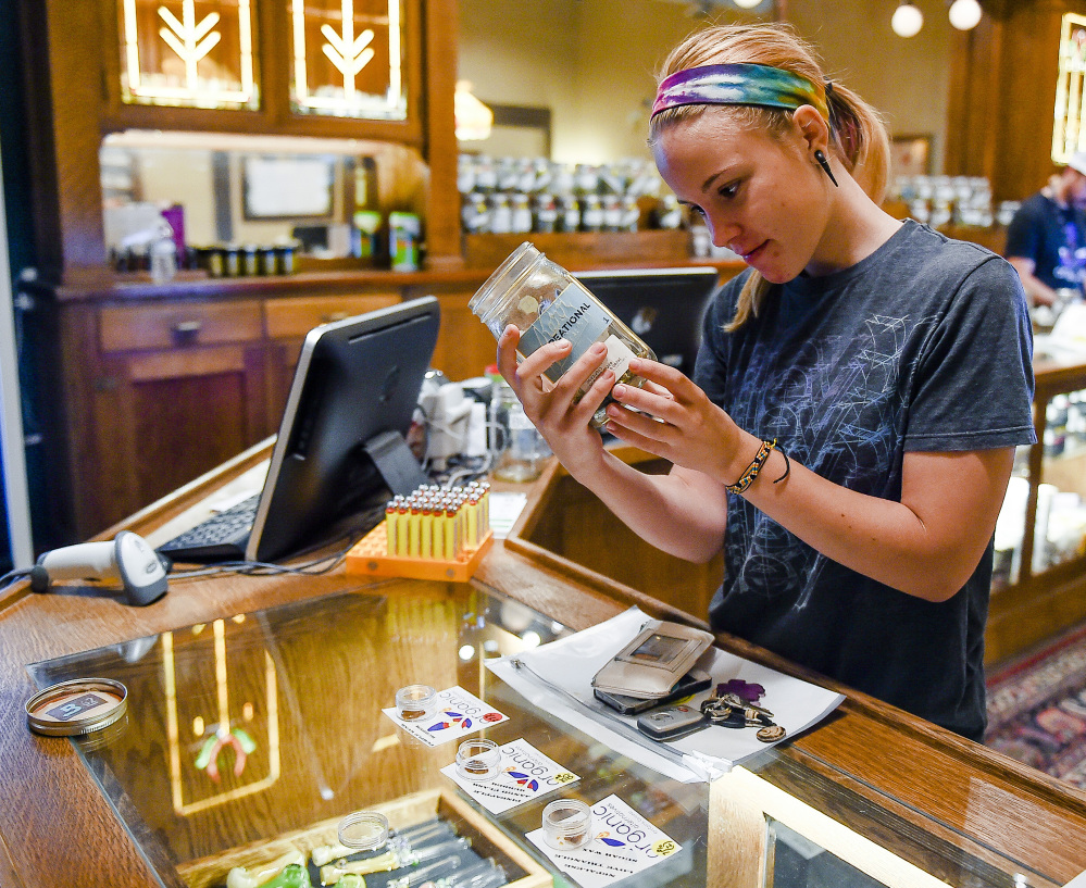 Shelby Johnson checks out products at Organic Alternatives during Colorado's marijuana tax holiday in Fort Collins, Colo.