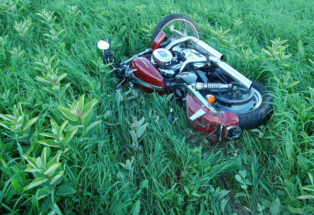 The Harley-Davidson ridden by Jonathan Billings of Windham lies in the field in New Sharon where Billings crashed in August. Police said Billings, 24, was speeding and not wearing a helmet when his motorcycle left the road and hit a fence post off Route 27.