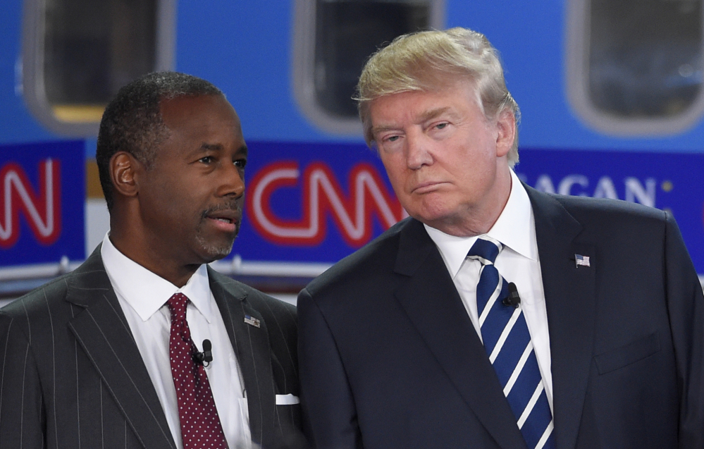 Ben Carson, left, who recently abandoned his bid for the Republican presidential nomination, is planning to endorse Donald Trump on Friday, the Washington Post reports.
