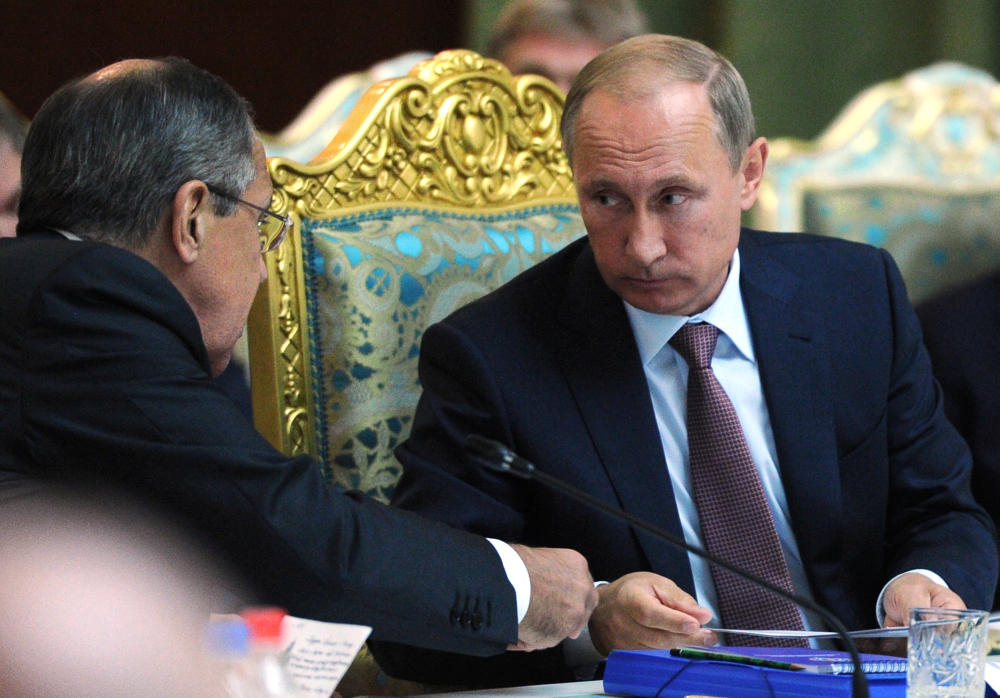 Russian President Vladimir Putin, right, and Foreign Minister Sergey Lavrov say Moscow's assistance is necessary for Syria to defeat the Islamic State.