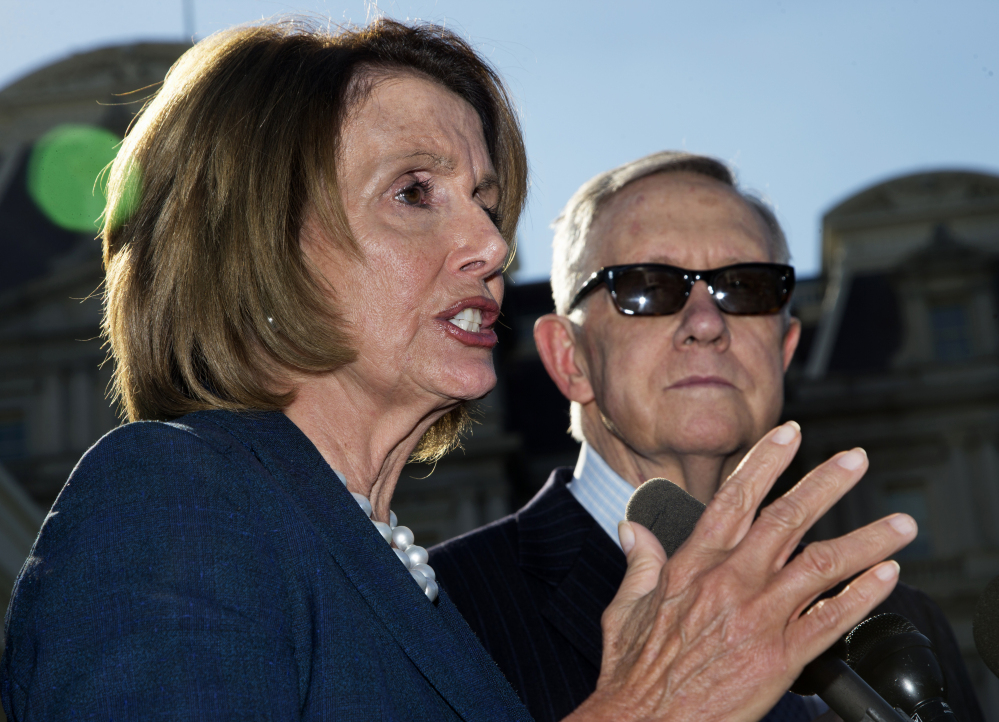 House Minority Leader Nancy Pelosi and Senate Minority Leader Harry Reid leave a meeting with the president over short-term government funding.