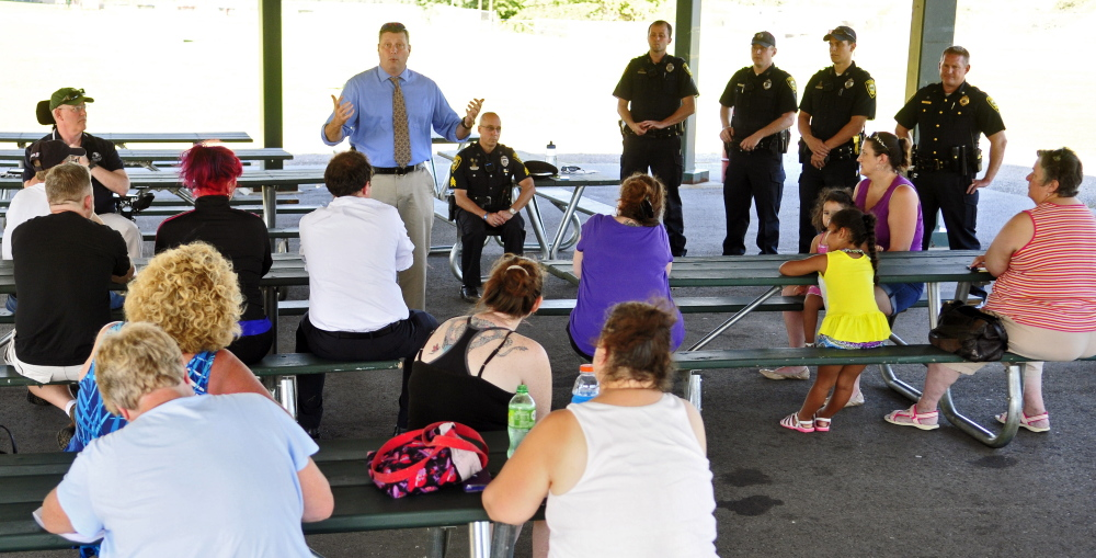 Augusta police Lt. Christopher Massey, center, talks about efforts to reduce crime during a public meeting Thursday at the base of Sand Hill in Augusta.