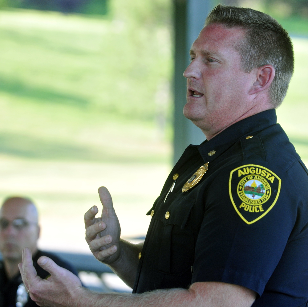 Augusta police Deputy Chief Jared Mills speaks during a public meeting Thursday in the Mill Park gazebo at the base of Sand Hill in Augusta.