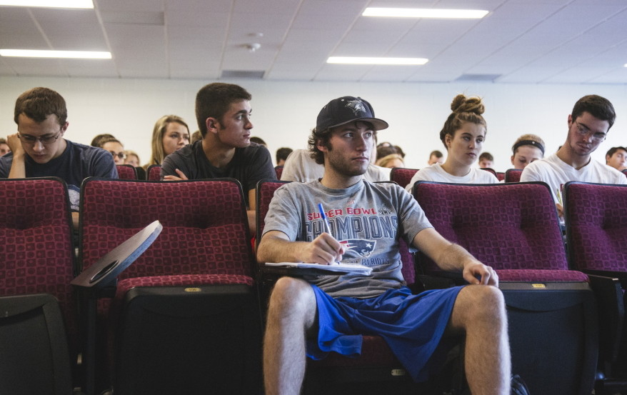 "Senior Chris Carrigan and others listen to professor Michael McCann during a Deflategate class at UNH on Wednesday. ""You see the title, 'Deflategate,' and you say, 'How is that useful?' McCann said. ""Learning what labor law is, learning what antitrust law is ... is very useful."""