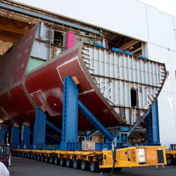 The Pentagon is reviewing whether to cancel construction of the third Zumwalt-class destroyer, now 40 percent complete at Bath Iron Works. The decision could have far-ranging effects as the shipyard is Maine's fifth-largest private employer and spent upwards of $60 million last year with companies in its supply chain. Above, a hull section, seen in 2011, from the first of the three Zumwalt-class destroyers, which is scheduled to start undergoing tests in November. Courtesy of Bath Iron Works