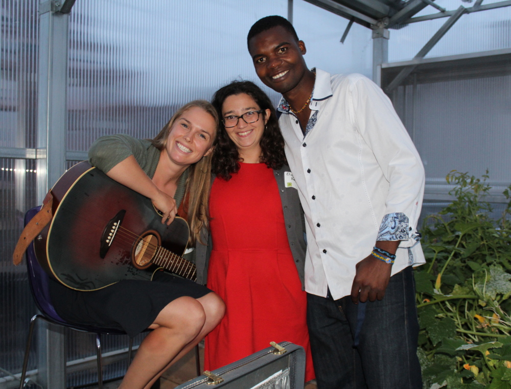 Caroline Cotter, left, Elizabeth Reardon and resident gardener Chomba Kaluba at the 409 Cumberland harvest party for the gardens and greenhouse on the Portland apartment building's roof.