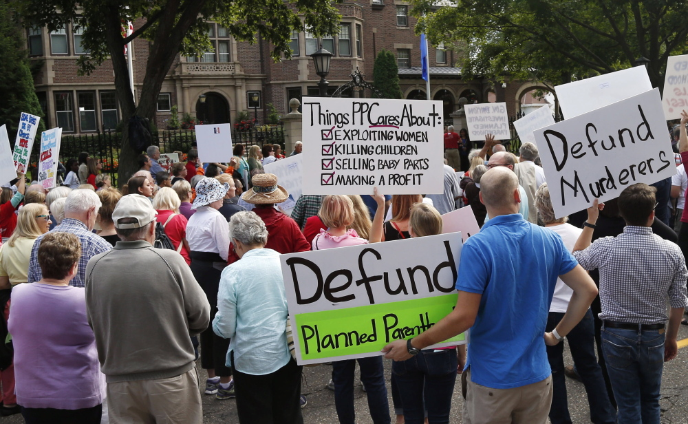 Planned Parenthood protests, like this one in St. Paul, Minn., have been helping an effort in Congress to shut down funding to Planned Parenthood. A House bill would bar federal funds unless the Planned Parenthood organization certifies that it will not perform abortions.