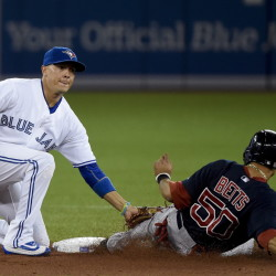 Boston Red Sox's Mookie Betts (50) is tagged out at second base by Toronto Blue Jays shortstop Ryan Goins on an attempted steal during the second inning Friday in Toronto.
