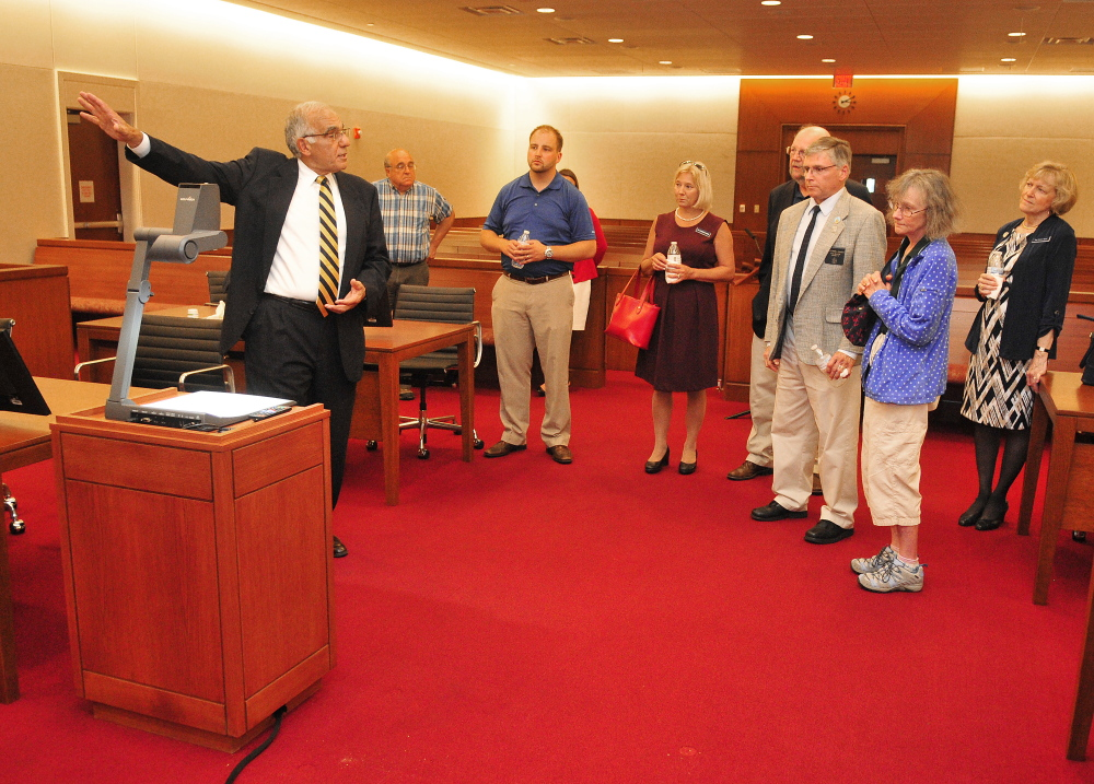 Supreme Court Justice Joseph Jabar leads a tour of a large courtroom Friday after the ceremonial opening of the Capital Judicial Center in Augusta.