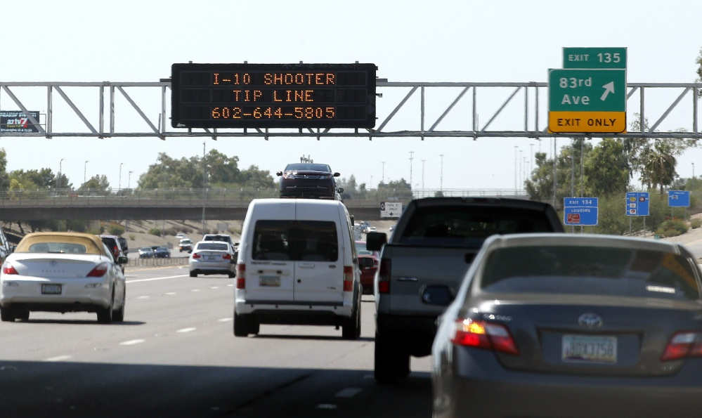 A sign still displays a shooter tip line above Interstate 10 in Phoenix.