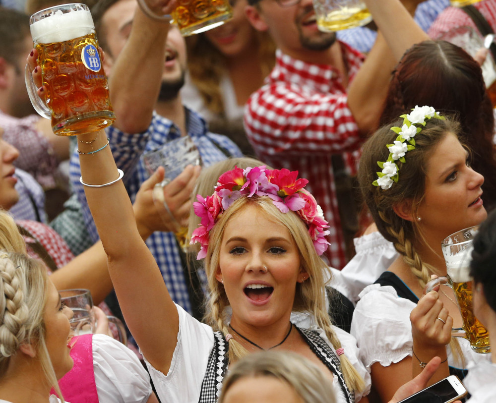 A young woman celebrates the opening of the 182nd Oktoberfest on Saturday in Munich, Germany. Some 6 million visitors are expected at the beer festival through Oct. 4.